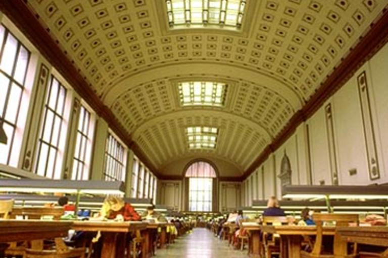 A zoomed out image of the reading room within Doe Library, with views of the grid-like ceiling pattern.