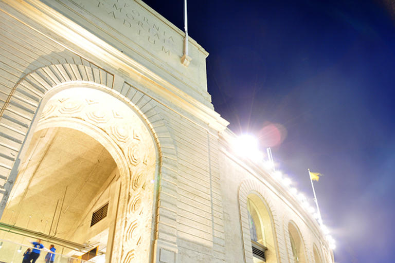 A shot of the Memorial Stadium at night, with the camera angled upward.