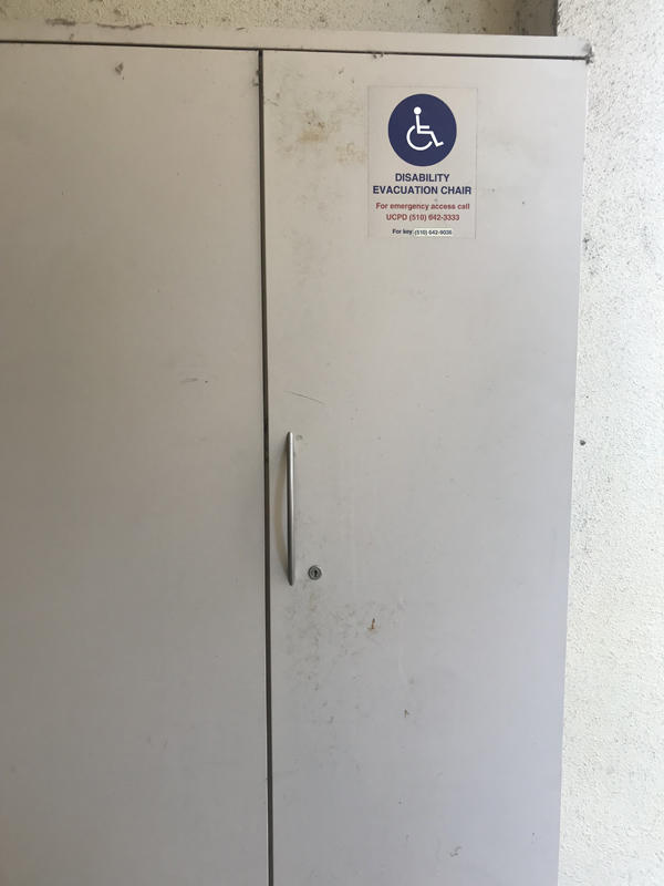 The evacuation chair for Moses Hall, located outside the east entrance. It is positioned in an evacuation cabinet.