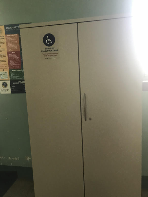 The evacuation chair for Mulford Hall, located near the northside entrance. It is situation in an evacuation cabinet.