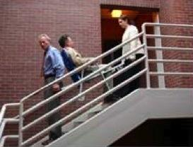 When evacuating down stairs, make sure the passenger always faces up the stairs.