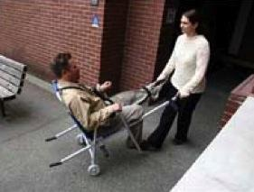 Lift front of chair and roll passenger out of the building and to safety.
