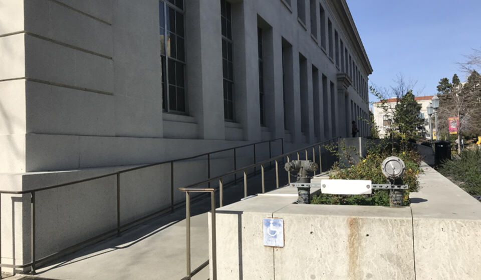 The accessible entrance to the Bancroft Library, facing north. The access path is a ramp starting to the left.