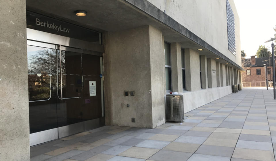 The accessible entrance to Berkeley law, facing west. There is an automatic door opener to the right of the entrance.