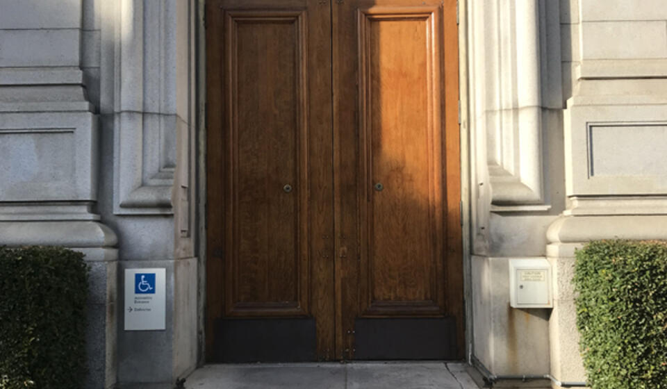 The south side accessible entrance to California Hall. An intercom to the right of the entrance is used to open the door.