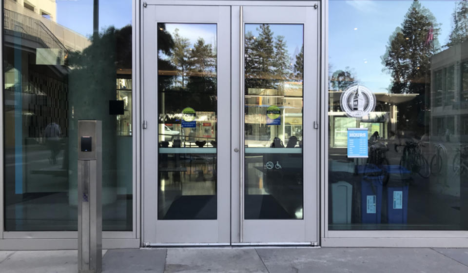 The north entrance to Eshleman Hall. To the left of the doors is an automatic door opener.