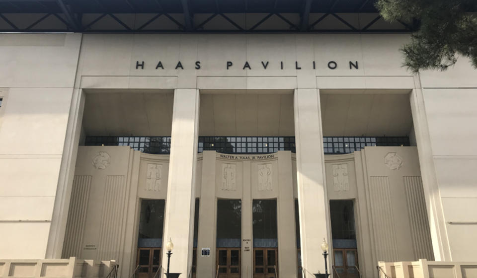 The front side of Haas Pavilion, facing east. In front of the entrance is a small staircase. The access ramp is to the left.