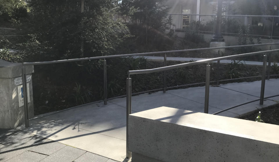 The accessible ramp to enter the courtyard of Haas, which is located to the right of the staircase.