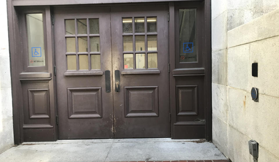 The accessible doors to Hearst Mining. To the right of the entrance is an automatic door opener.