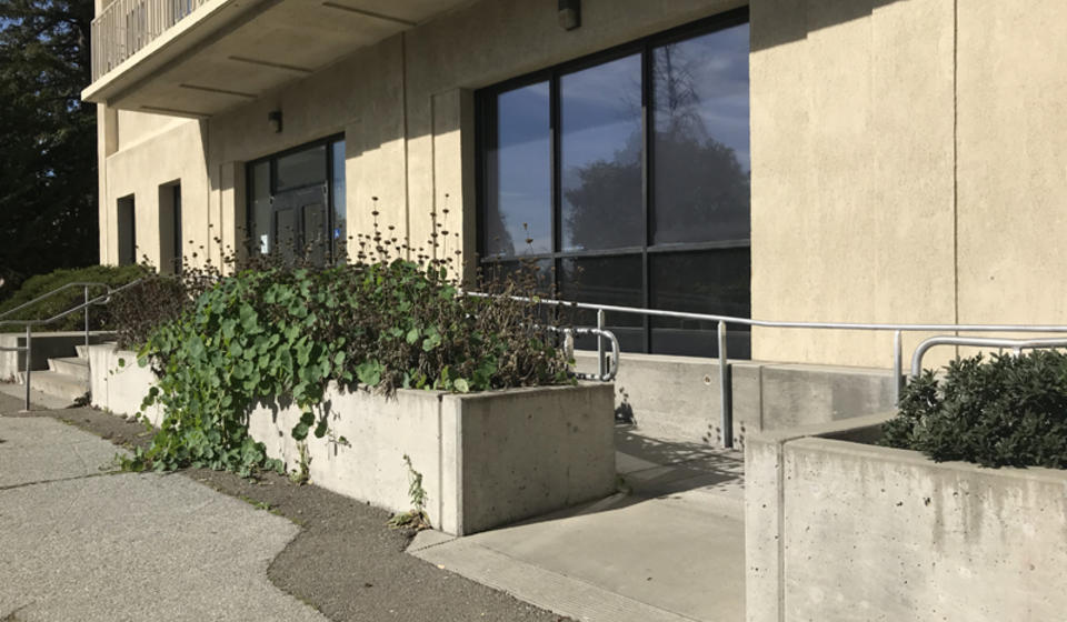 The south side accessible entrance to McCone Hall. The ramp is located to the right of the entrance's stairs.