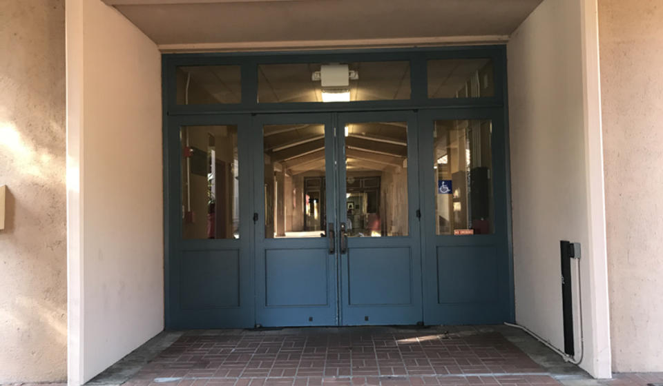 The main entrance to Morrison Hall, facing east. To the right of the entrance is an automatic door opener.