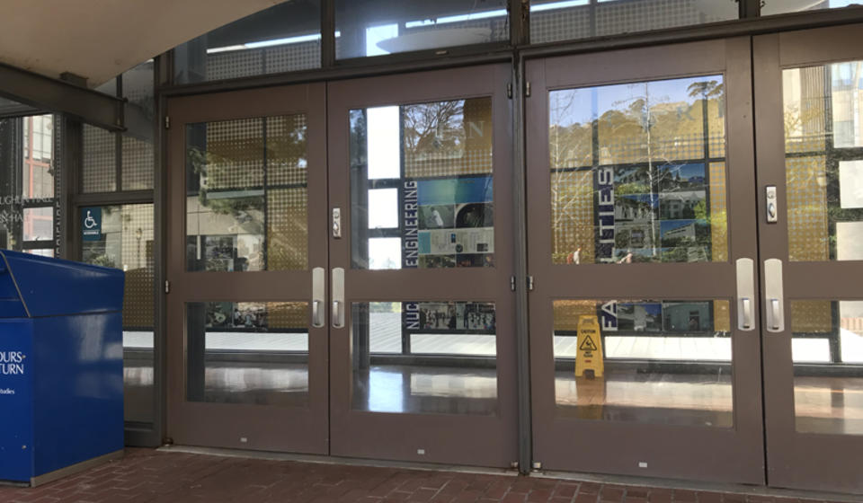 The main entrance to O'Brien Hall, facing east. To the left of the leftmost set of doors is an automatic door opener.