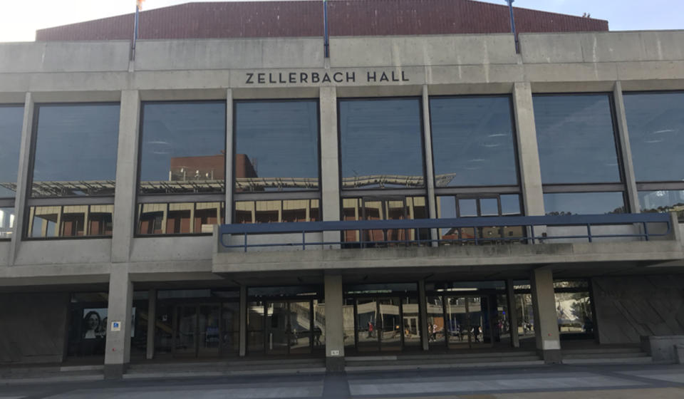 The front side of Zellerbach Hall, facing east. The accessible path is a ramp on either side of the main entrance.