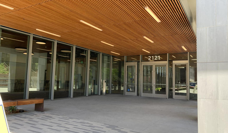 The southeast entrance to Berkeley Way West. To the left of the leftmost set of doors is an automatic door opener.