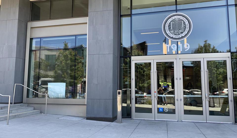 The west entrance to Berkeley Way West. To the left of the doors is an automatic door opener.