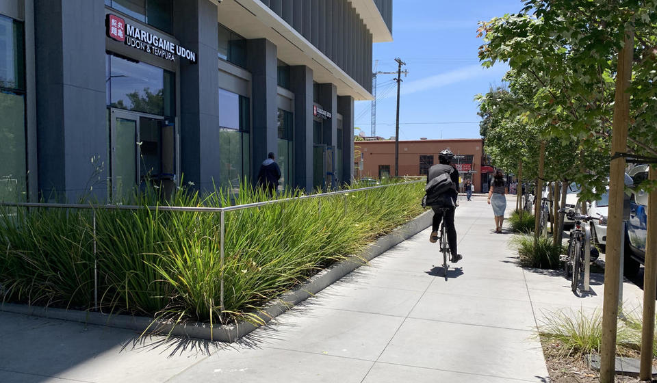 The path of travel to Berkeley Way West's west entrance. Its small plaza leads to the sidewalk on Shattuck Avenue.